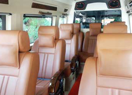 9 seater deluxe 1x1 tempo traveller